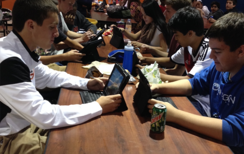A girl left clinging to her precious iPhone syncs in a sea of iPads