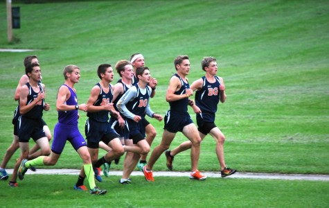 Boys cross country sprints to the finish