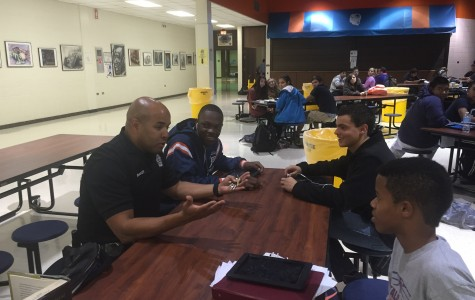 Officer Malcolm Baker interacts with a small group of students.