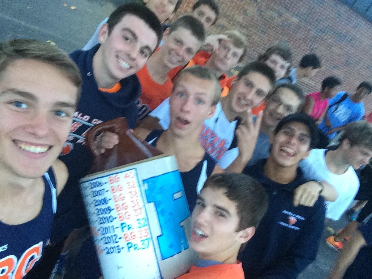 Cross country team wins the MSL East Division and celebrates with a selfie.