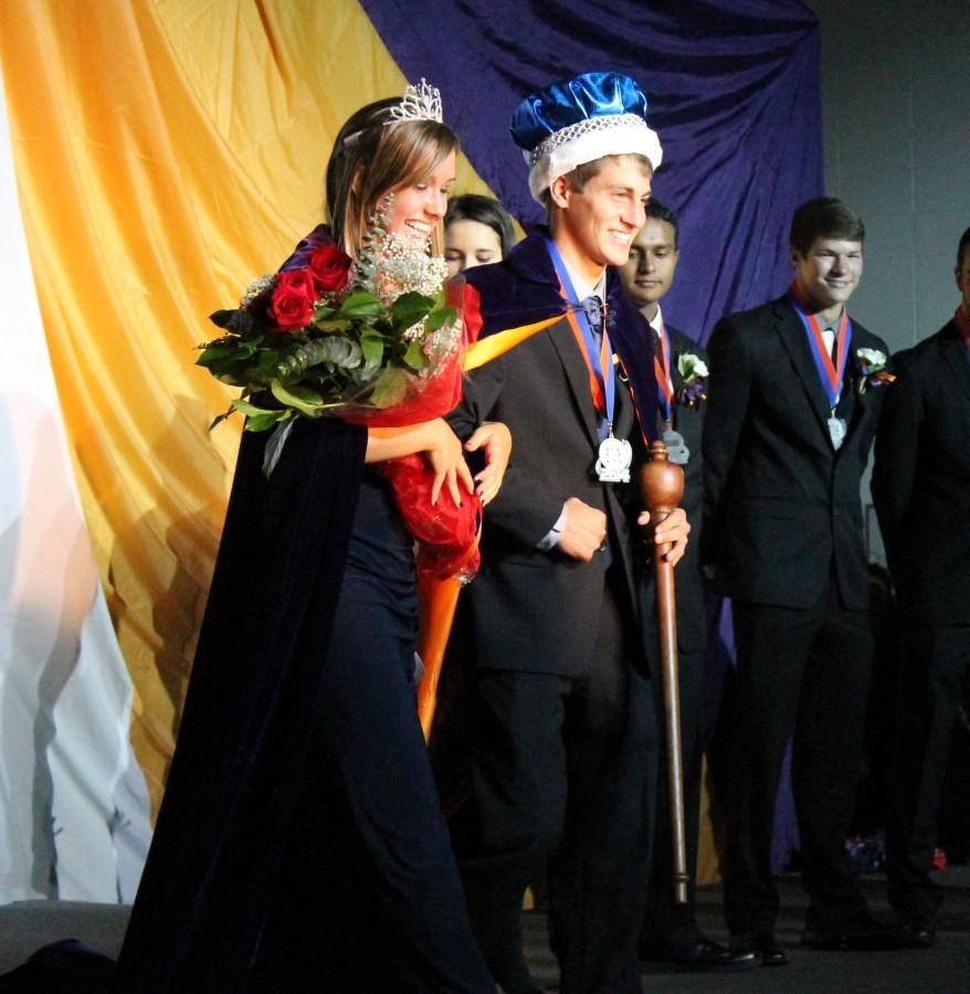 King+Zack+Masciopinto+and+Queen+Teagan+Nelson+parade+around+the+gym+after+having+just+been+crowned.