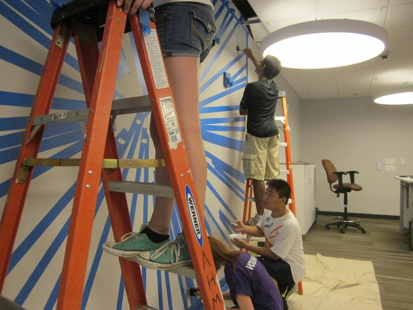 The Teen Advisory Board builds a floor-to-wall clock at the Arlington Heights Memorial Library.