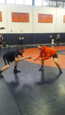 Varsity wrestlers Devin Curran and Alex Horvat practice their technique at a recent practice.