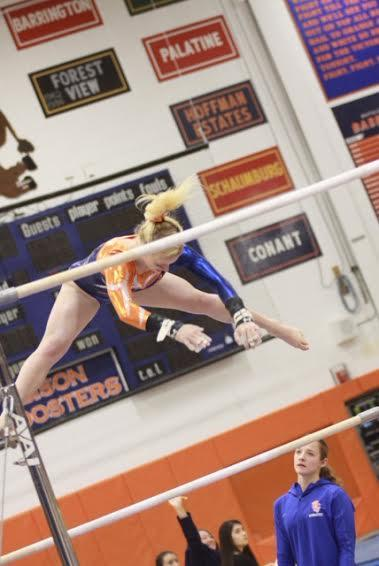 Junior Diandra Duenser performs her routine during the only home invite of this season vs Conant on Dec. 3.