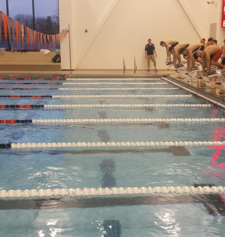 The+swimming+team+gets+ready+for+a+recent+meet+against+Wheeling+at+the+new+natatorium.+