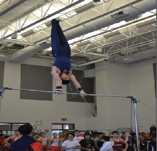 Senior Tyler Cho performs on the bars