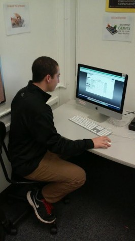 Senior Zack Mellow uses Infinite Campus to check his grades as well as his attendance report.