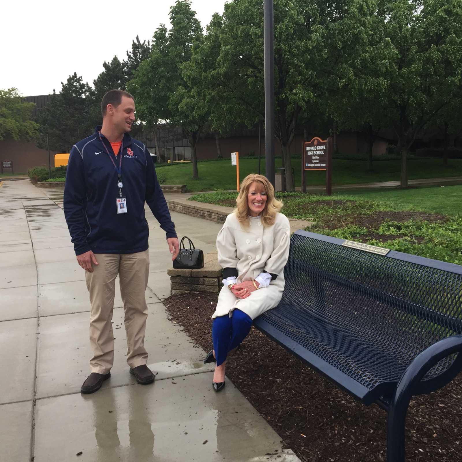 Former BG principal Carol Burlinski sits on honorary bench alongside principal Jeff Wardle.