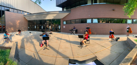 BG Orchestra members practice at a socially distant outdoor rehearsal near the circle drive.