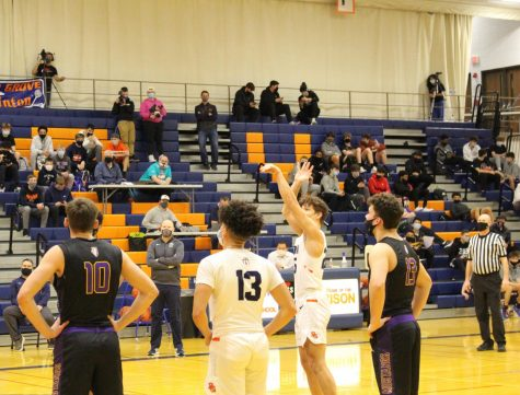 Ayden Anderson takes a free throw shot at line as teammate, Stephen Harris prepares to defend.