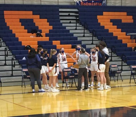 Bison varsity girls basketball takes a timeout during their Friday night game vs. EG to strategize.